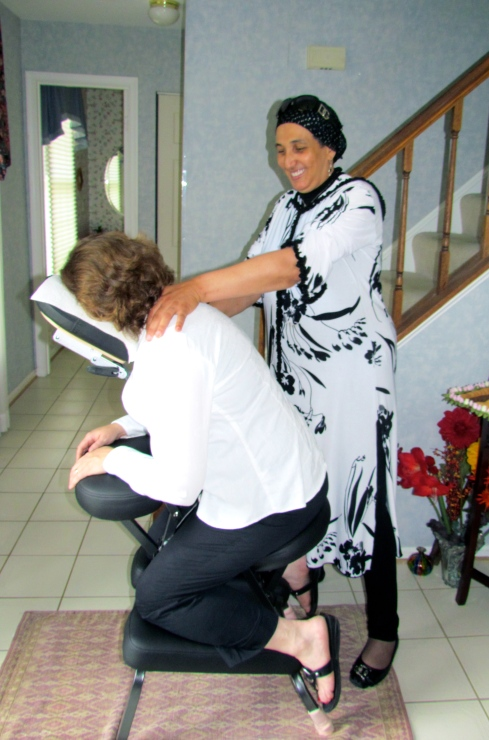 Kamar at a recent EWI Home Party, where she offered guests 15 minutes of massage for $15.