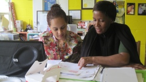 Former ETS student, Kudzai working with a mentor.