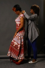 Tenisha dressing her model